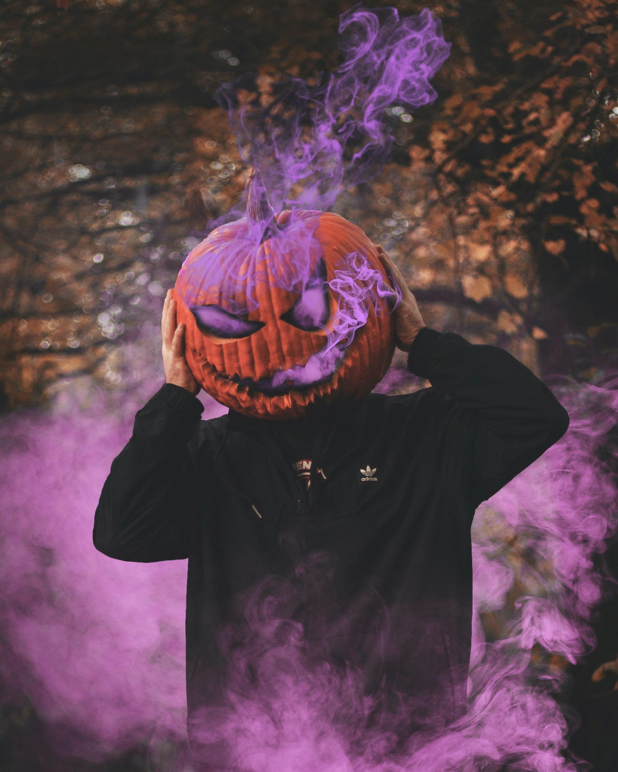 man with pumpkin on head